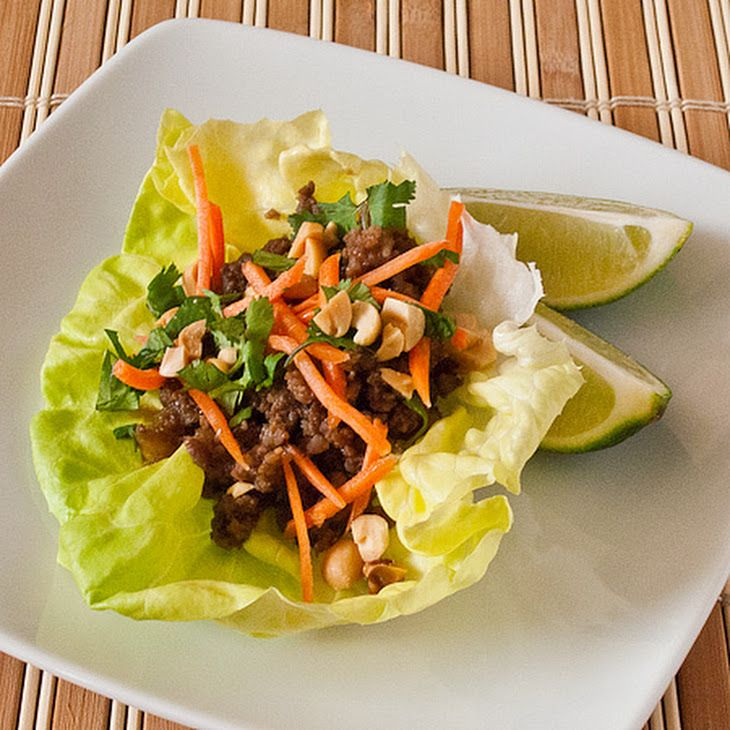 Asian Lettuce Wraps Recipe Appetizers, Lunch and Snacks, Main Dishes with ground beef, ground pork, onion, ginger, garlic, sugar, black bean sauce, crushed red pepper, lime juice, asian fish sauce, soy, butter lettuce, lime, shredded carrots, peanuts, cilantro