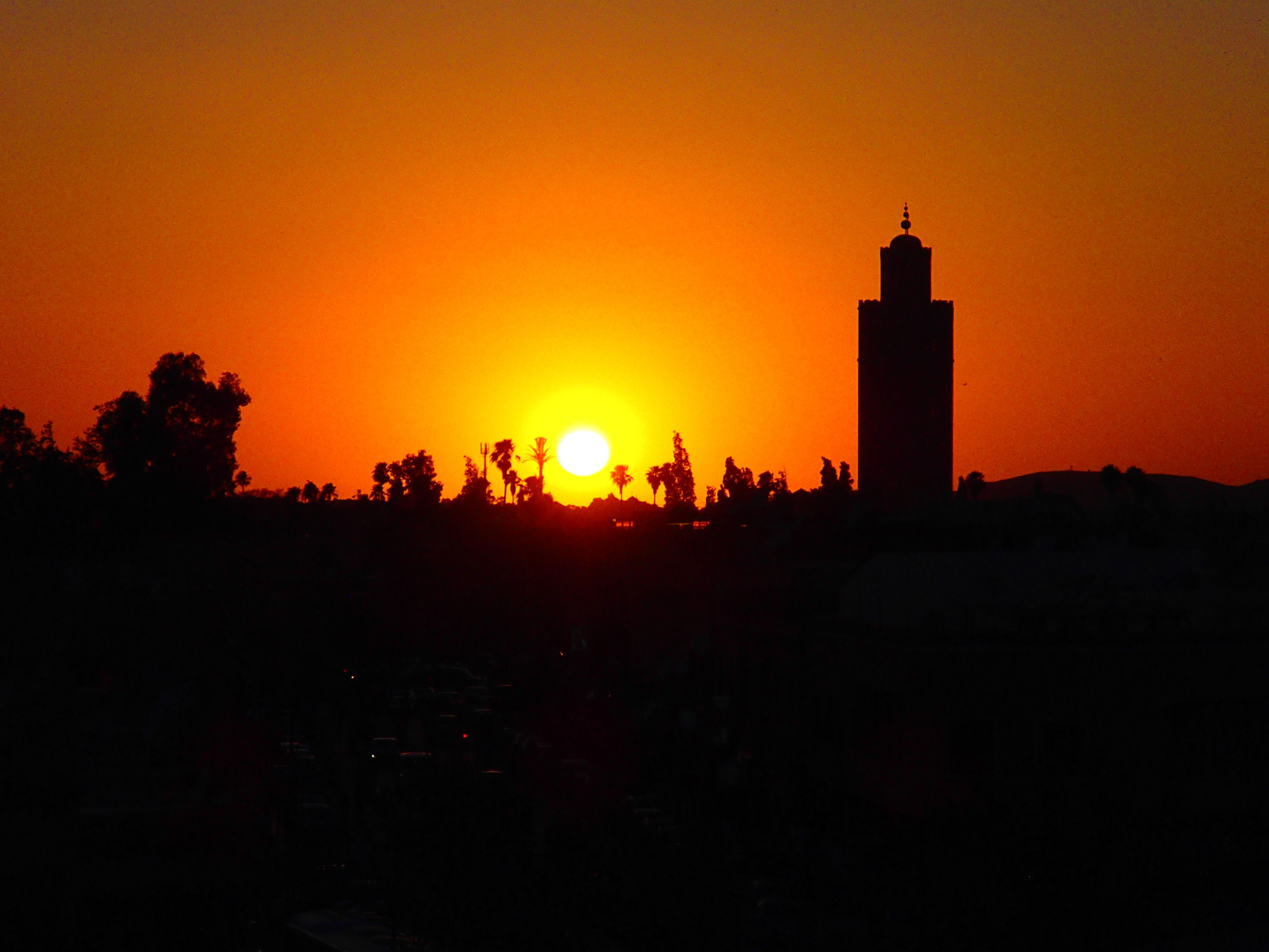 I snapped this from the balcony of the Cosy Bar in the Mellah, in Marrakech. The sun setting behind Koutoubia Mosque like a fire in the sky. Copyright Monique Drinkwater of www.popupsouk.com