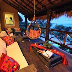 Terraços por DHI Riviera Maya Architects & Contractors