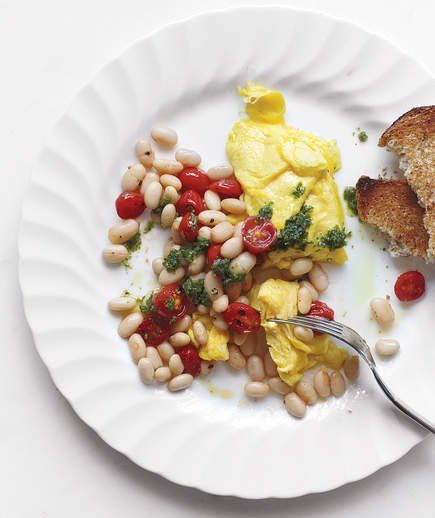 Scrambled Eggs With Beans, Tomatoes, and Pesto | Real Simple