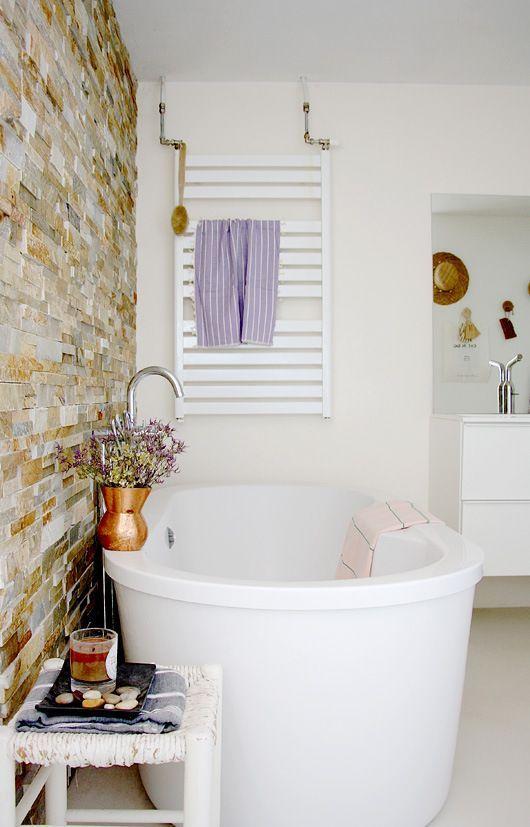 Stone wall behind tub
