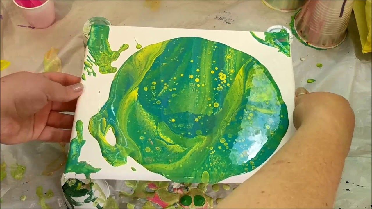 Green and yellow acrylic paint pour art by brooke