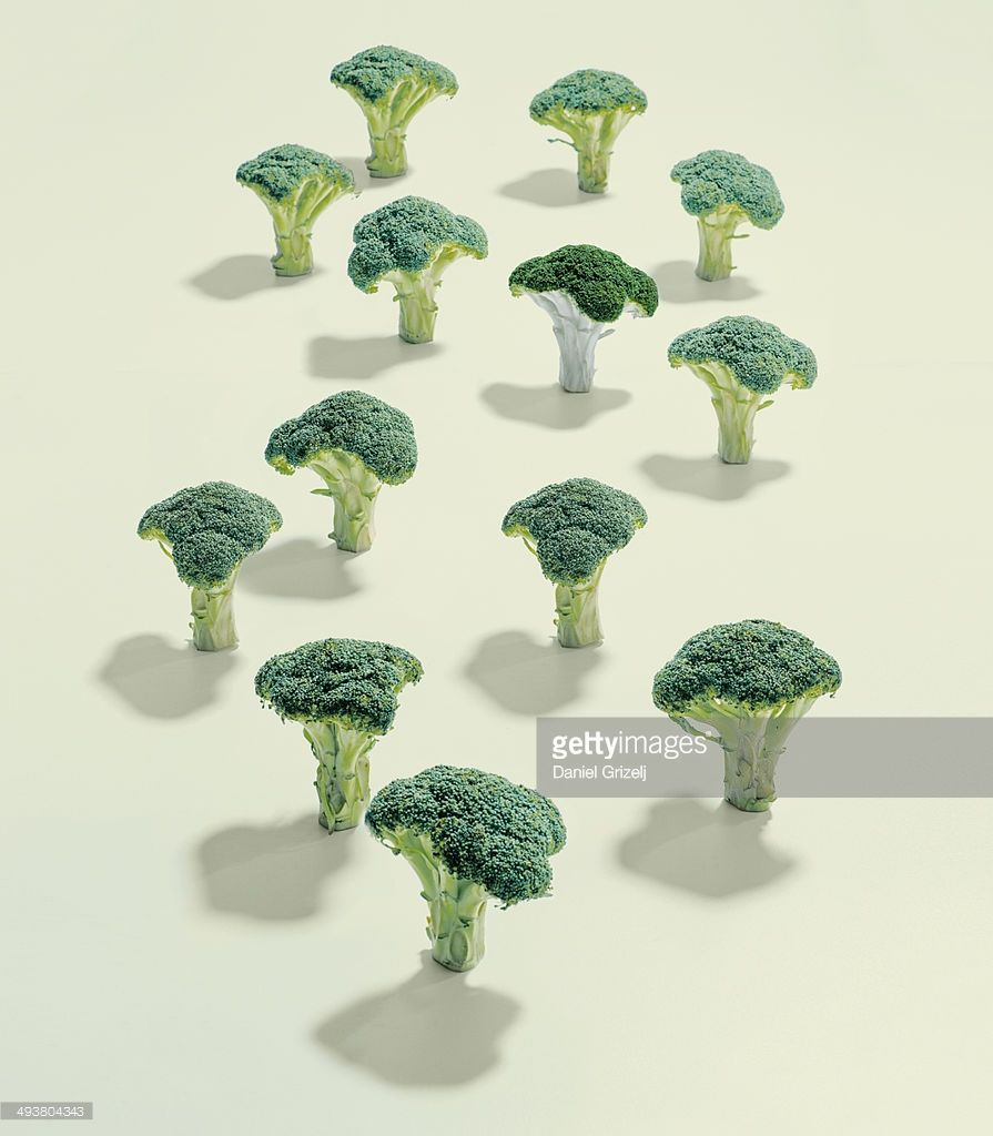 a group of broccoli and one which stands out
