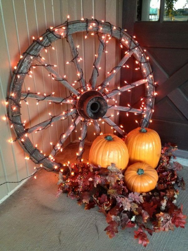 40 Beautiful DIY Rustic Decoration Ideas for Fall - Wagon - Ideas of Wagon #Wagon - Lighted Wagon Wheels for Fall Decor. Get the autumn porch decor with pumpkin and lighted wagon wheels. It will be the highlight for a special corner on your front porch and add an interesting centerpiece for the front porch table. #rusticporchideas