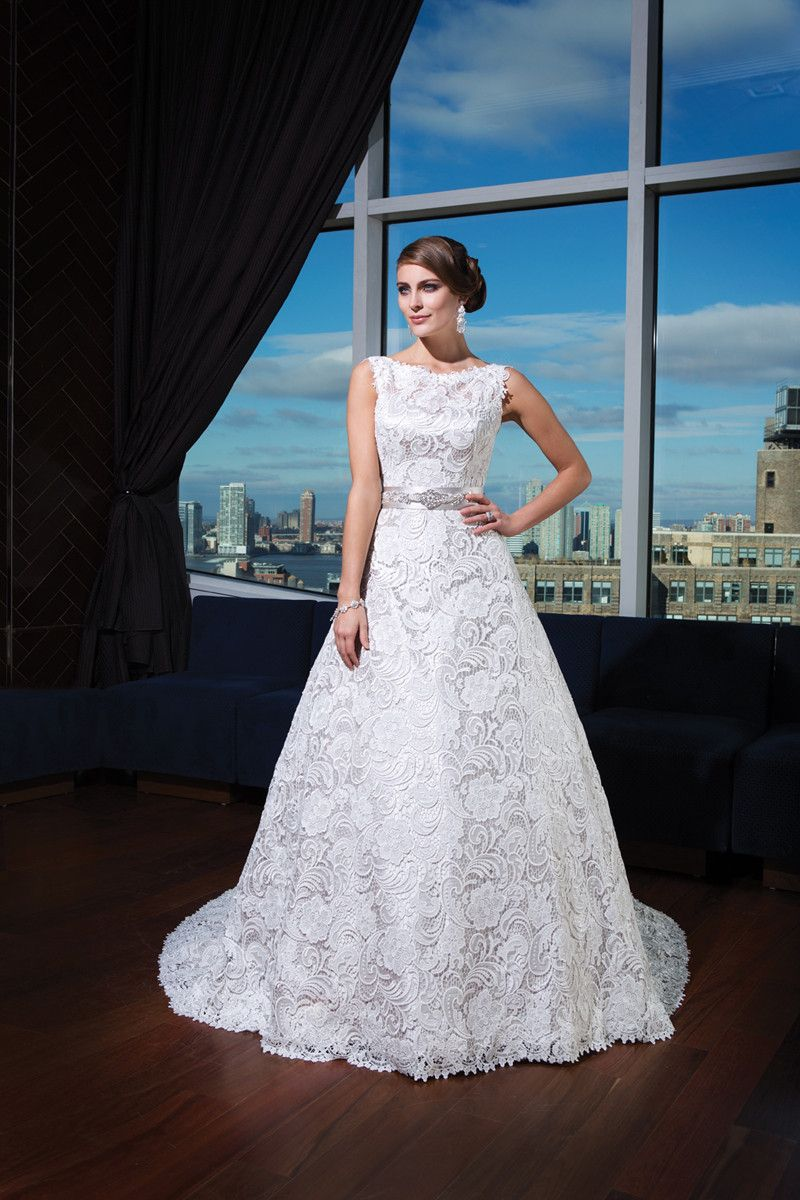 The lace overlay and high neckline is perfect for a rustic style