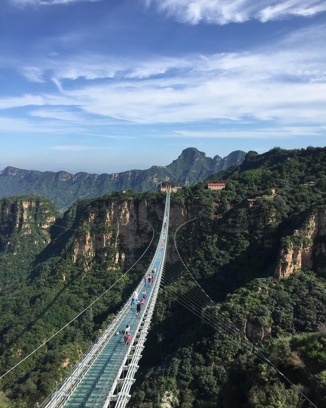 Enjoy The Scenic View Of China's Glass Bridge Constructed