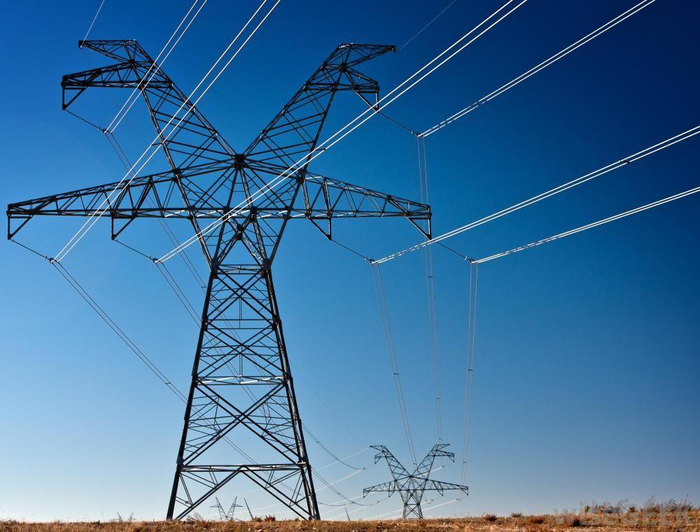 Power lines against blue sky jpg 1000x760
