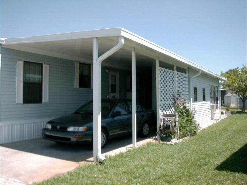 Carport vs Garage | Carport designs, Patios and House on mobile home exterior vinyl siding, mobile home drip rail, mobile home exterior colors, single wide mobile homes with cedar siding,