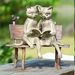 Reading Cats on a Bench