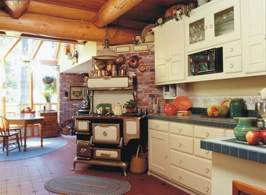 cream heartland appliances and cabinets with red reclamed ...