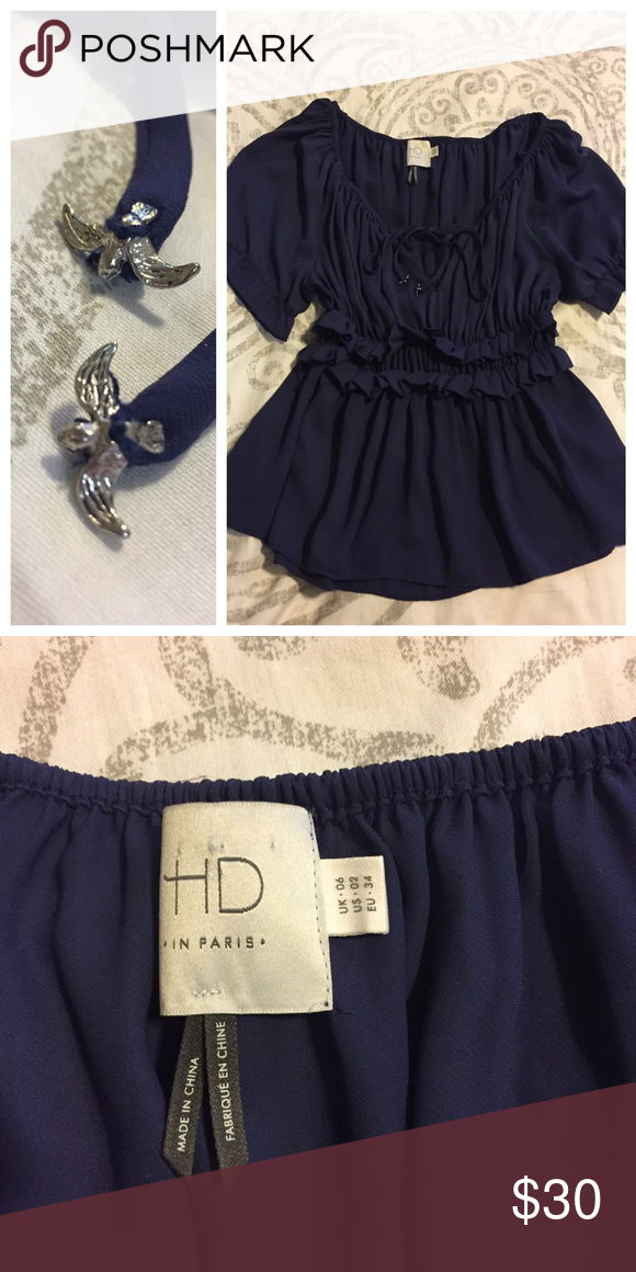 HD in Paris Navy Metal Bird Tie Blouse 2 No signs of wear. So cute. Small metal flying birds attached to the end of the keyhole ties. 100% polyester. Anthropologie Tops Blouses