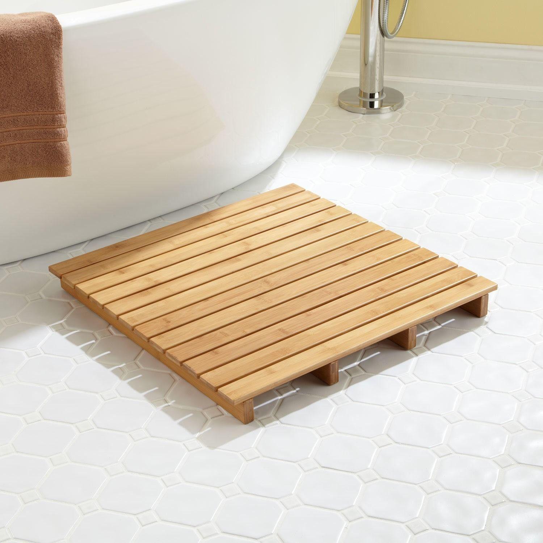 Yellow Bathroom With Wooden Bath Mat Containing Pedestal Bathtub