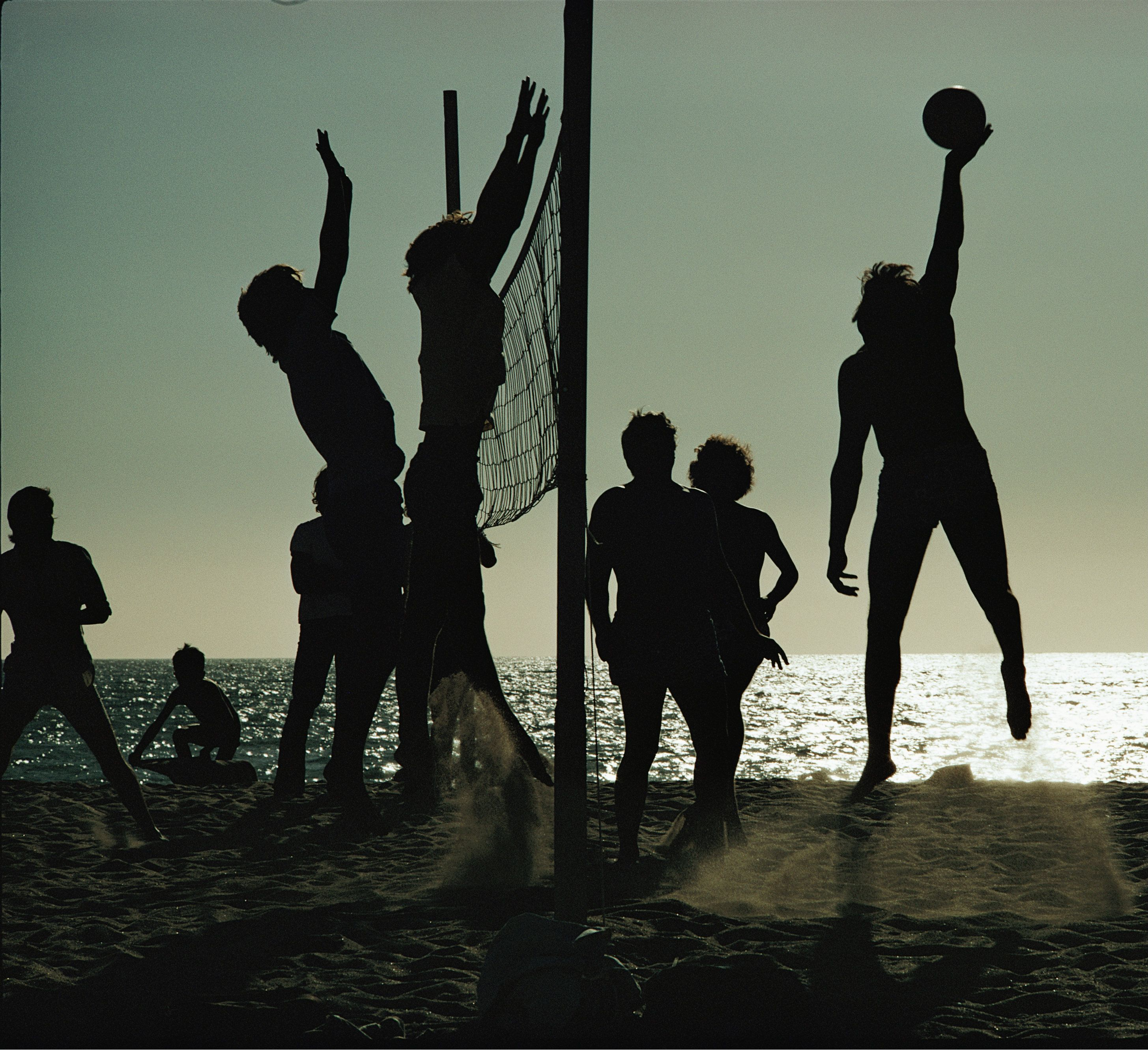 Young Men Playing Beach Volleyball Are Silhouetted Against Chile S Late Afternoon Sun While Beach Volleyball Has B Adventure World Hiking Map Beach Volleyball