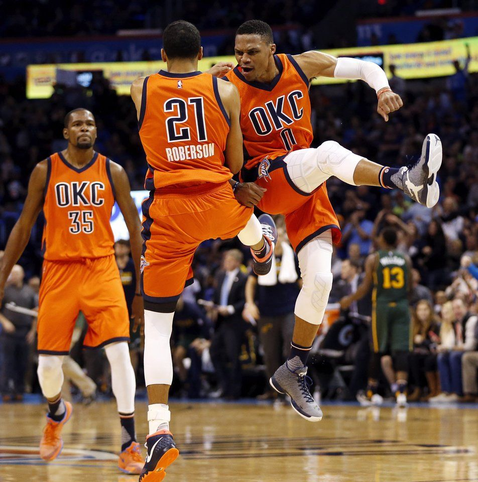 Oklahoma City's Andre Roberson (21) and Russell Westbrook (0) celebrate  near Kevin