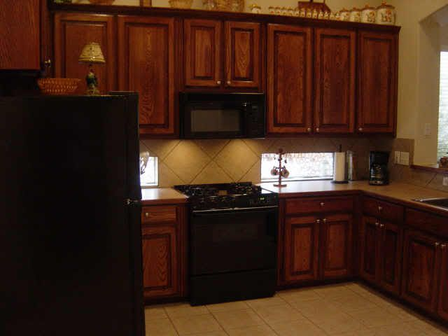 Black appliances with oak cabinets do you like the ss or for Kitchen cabinets with black appliances
