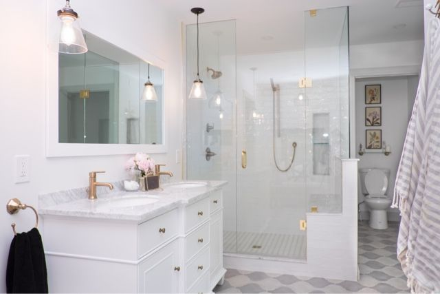 Photo of White and brass bathroom. Delta champagne bronze fittings. Project Jennifer- Sta …