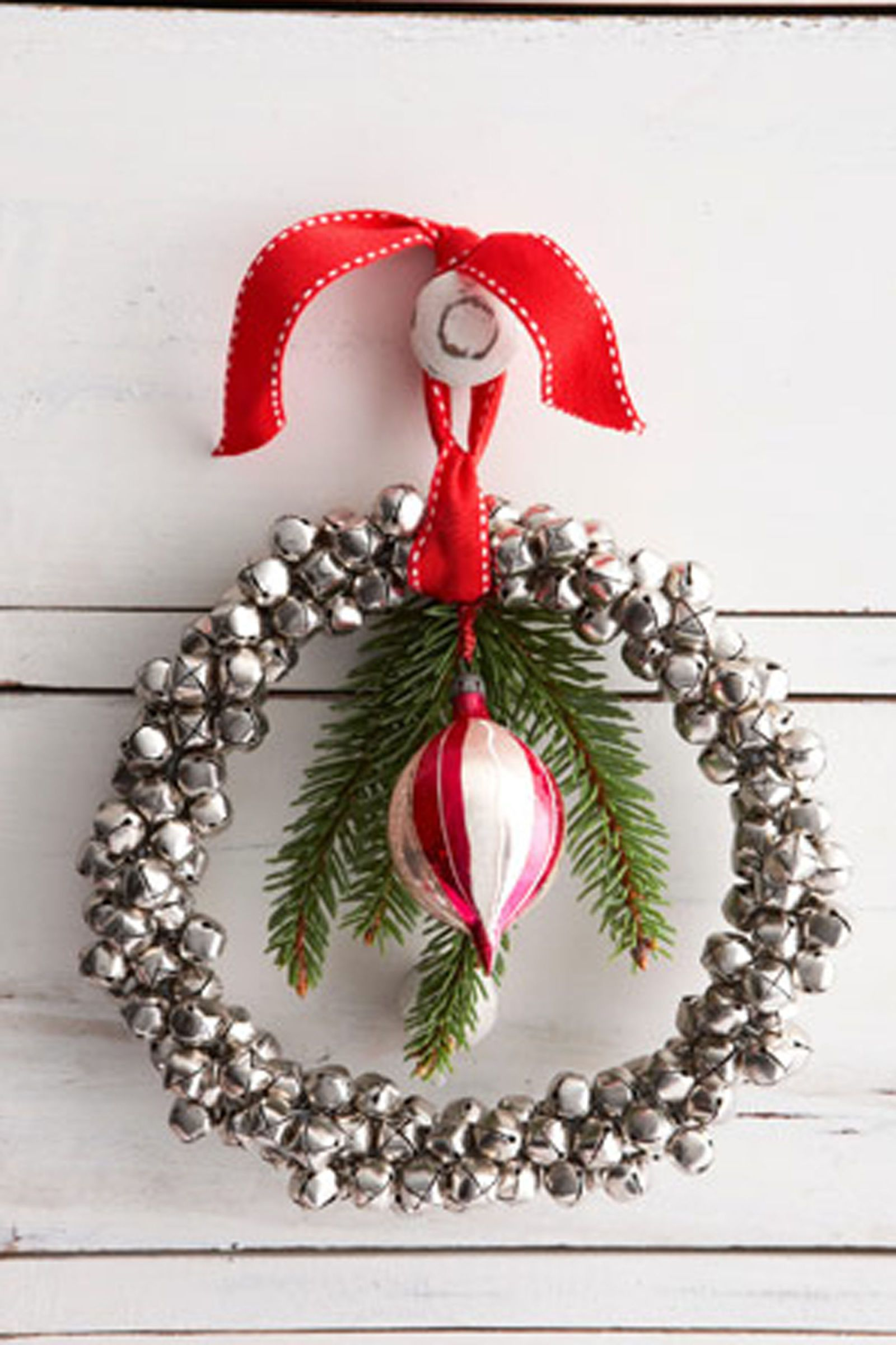 50 festive do it yourself christmas wreath ideas pinterest diy gift wrapping ideas jingle bell wreath countryliving solutioingenieria Gallery