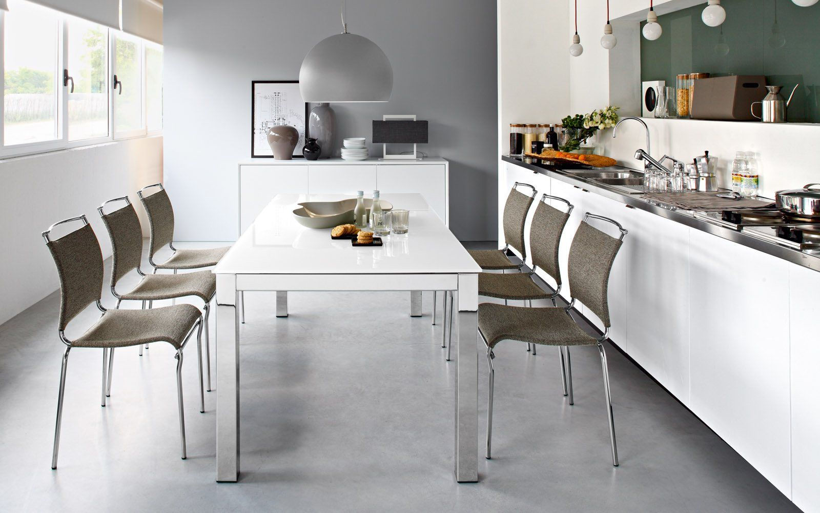 Modern Open Plan Kitchen With Calligaris Airport One Extending Table Air Chairs And