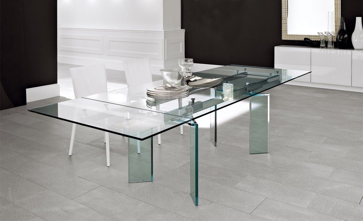 Designed By Paolo Cattelan, The Delta Dining Table Features A Glass Base  That Looks Like