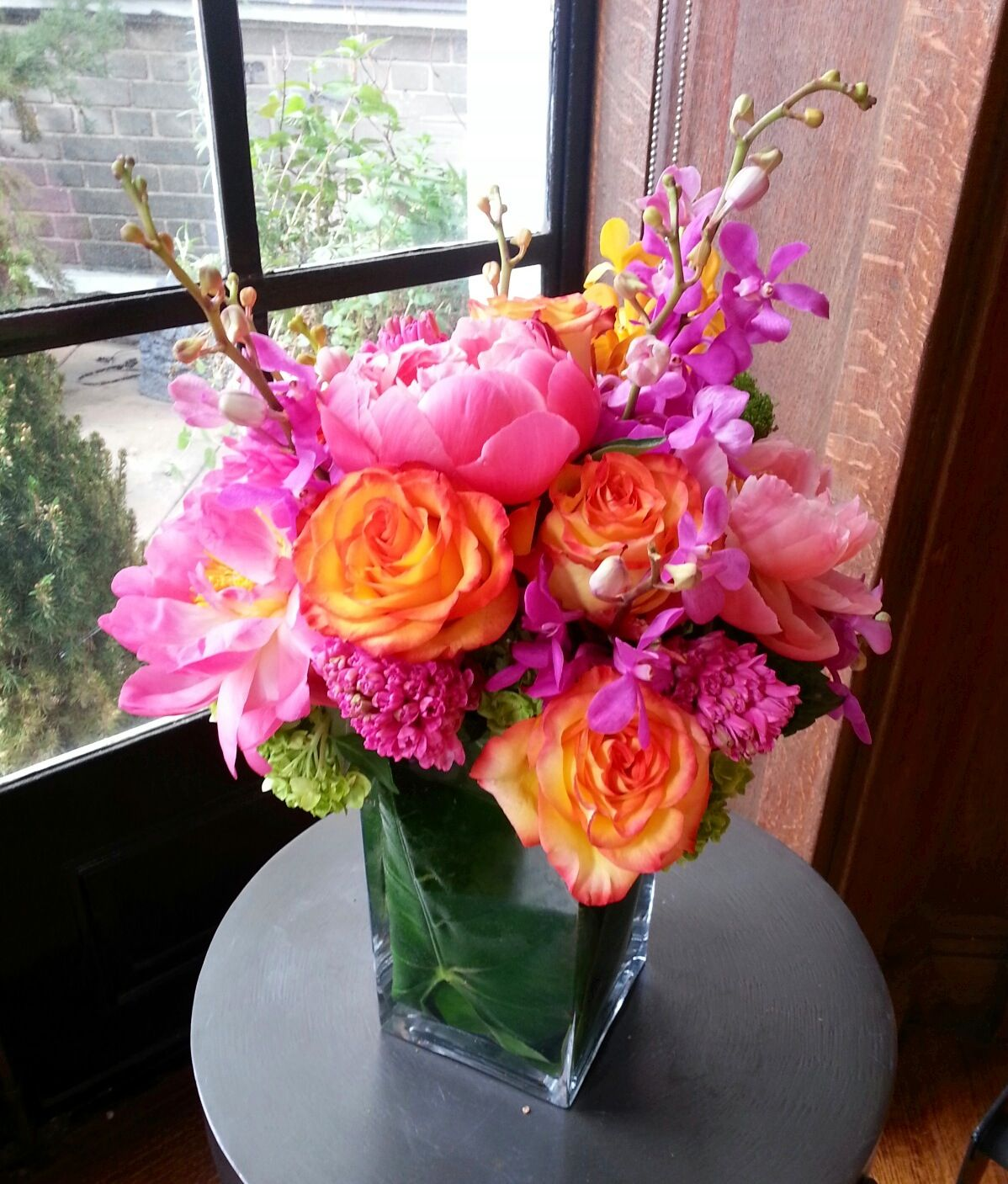 Bright Colors Side Table Arrangement Hot Pink Peonies Orange Roses Hyacinth Green Hydrangea Yellow And Orchids