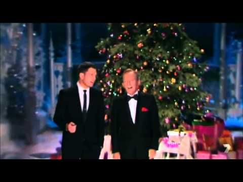 Thanks To The Wonders Of Technology Two Crooners Born Generations Apart Were Able To Share A Traditional Christmas Songs Christmas Music Videos Michael Buble