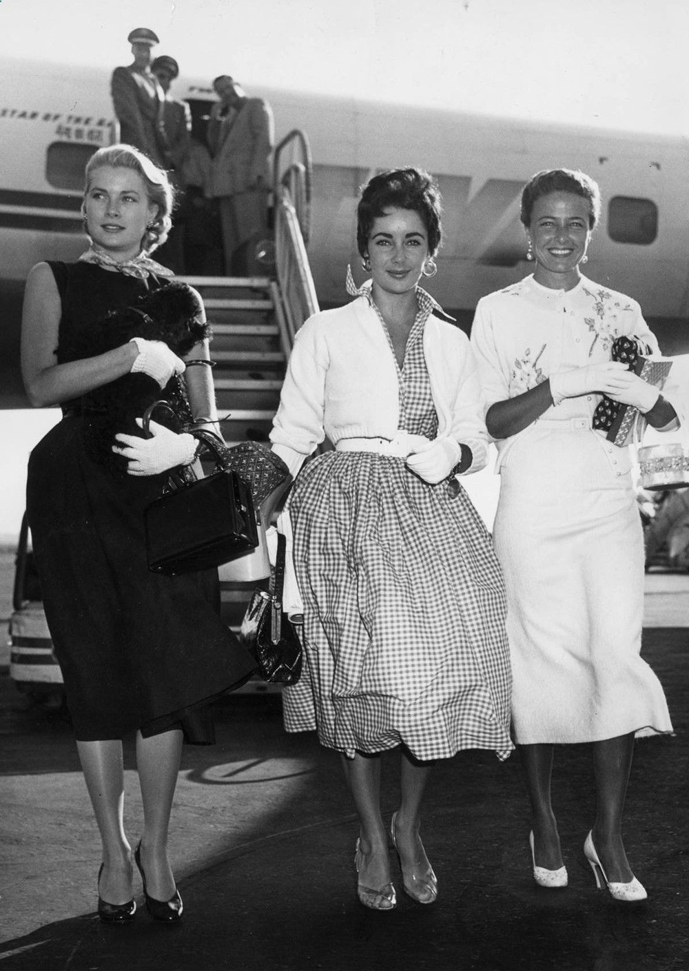 Grace Kelly, Elizabeth Taylor, and Laraine Day arriving at the New York International Airport, 1954 - Imgur