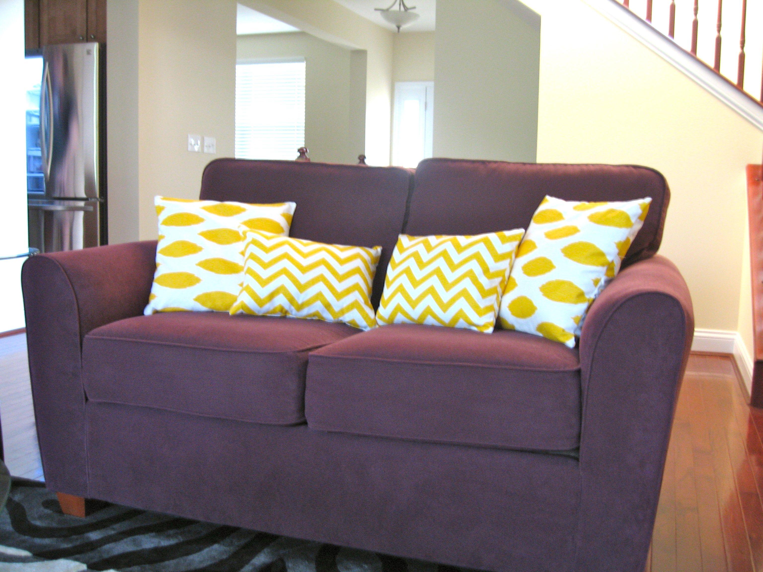 yellow throw pillows at www.twopurplecouches.wordpress.com