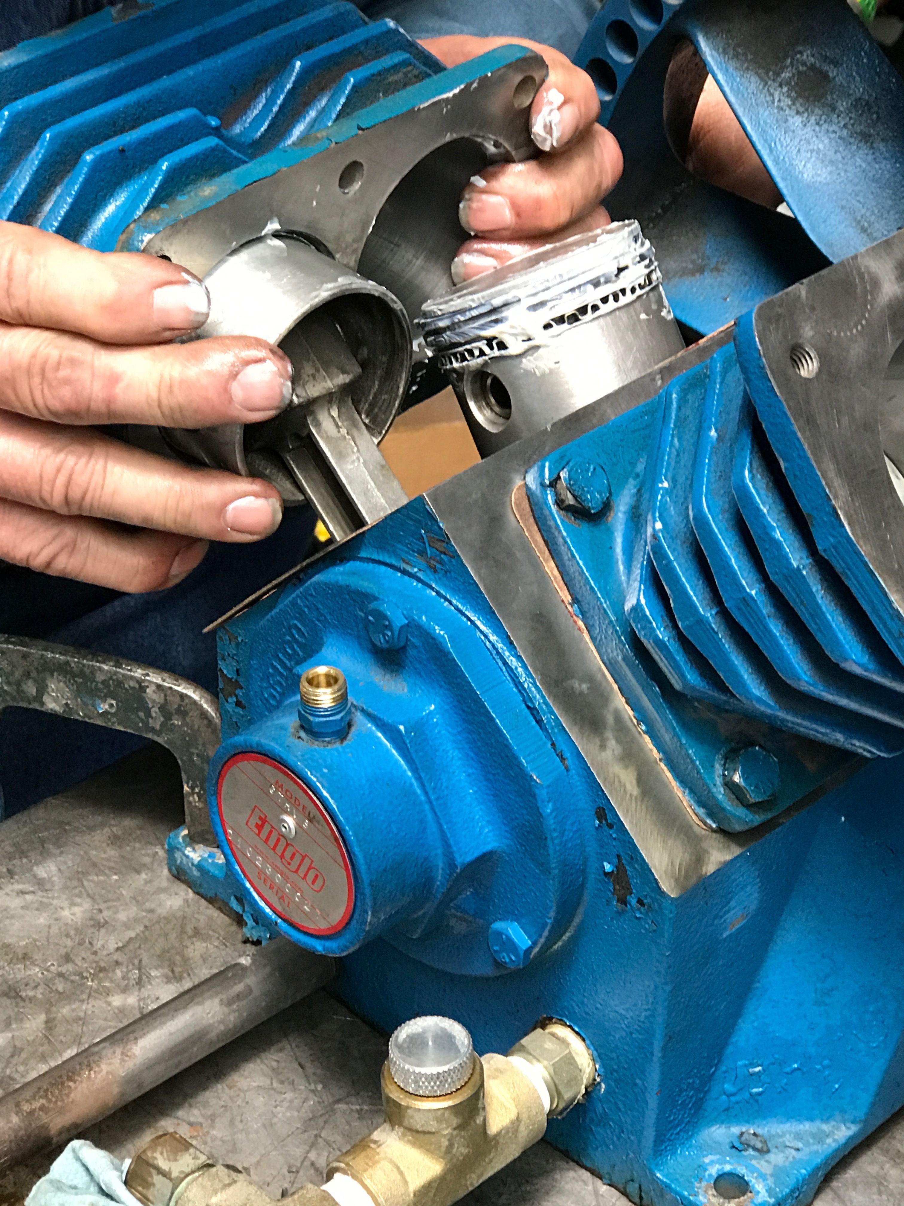 Rebuilding an Emglo air compressor pump.