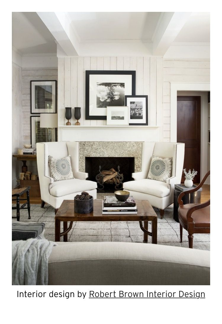 Chairs in front of fireplace and pics on side Neutral Living Rooms