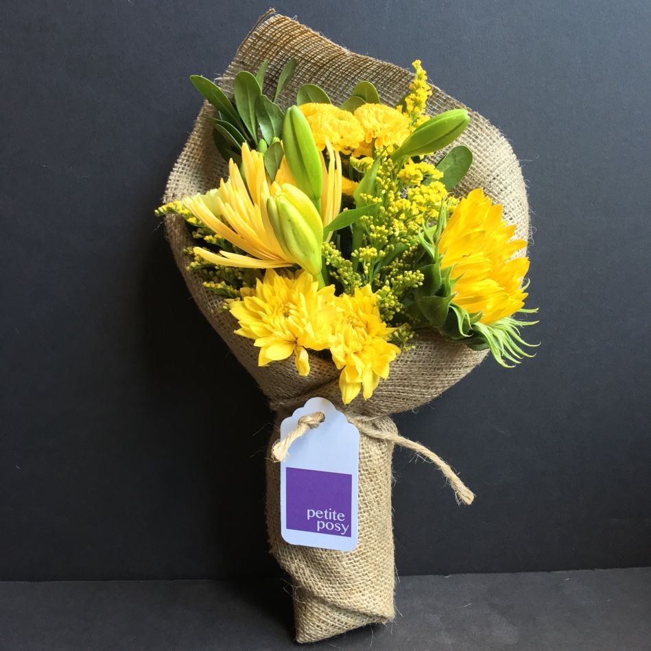In case you can't tell... YELLOW is out favourite color flowers! Today's Posy: Sun Flower, Lilies, Spider Mums, Chrysanthemums, Solidago and Pompoms with Green Pittosporum. Only $25 delivered right now! (Manhattan only, below 110th)  #florist #manhattan #newyork #posy #petite #petiteposy #petiteposyny #sunflower #lily #lilies #spidermum #chrysanthemum #solidago #pompom #pittosporum #green #yellow #favourite