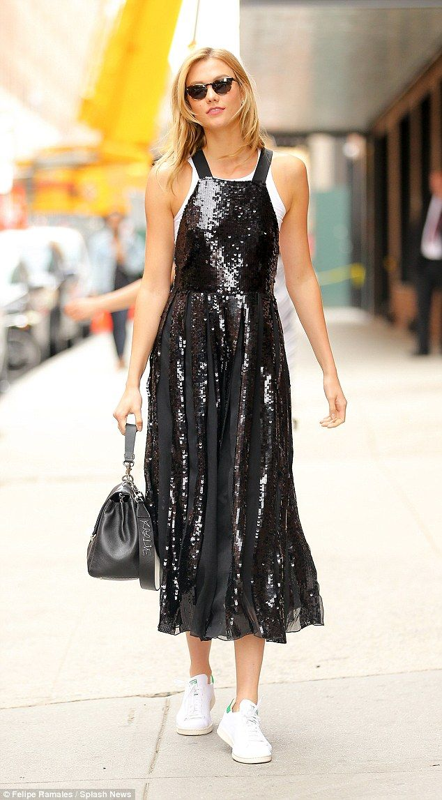Glitzy: Karlie took her party dress from night to day by pairing it with a white vest top ...