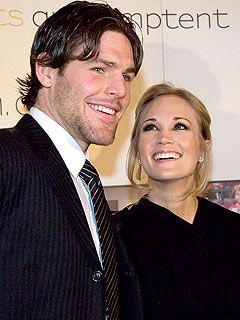 "Nearly two years into their marriage, the flame is still going strong for Carrie Underwood and Mike Fisher. ""I mean, he's hot!"" Underwood gushed to PEOPLE: http://www.people.com/people/article/0,,20592899,00.html"