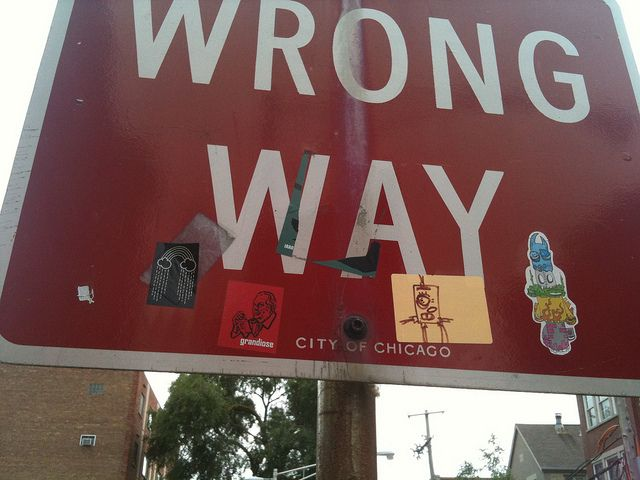 Wrong way sign with sonny rain clouds sticker and yob grandiose sticker chicago usa