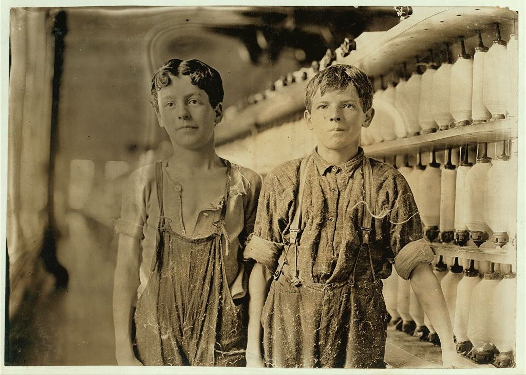 Mule-spinning room in Chace Cotton Mill, Burlington, Vt.  Leopold Daigneau (left) and Arsene Lussier (right). Burlington, Vermont in May 1909.