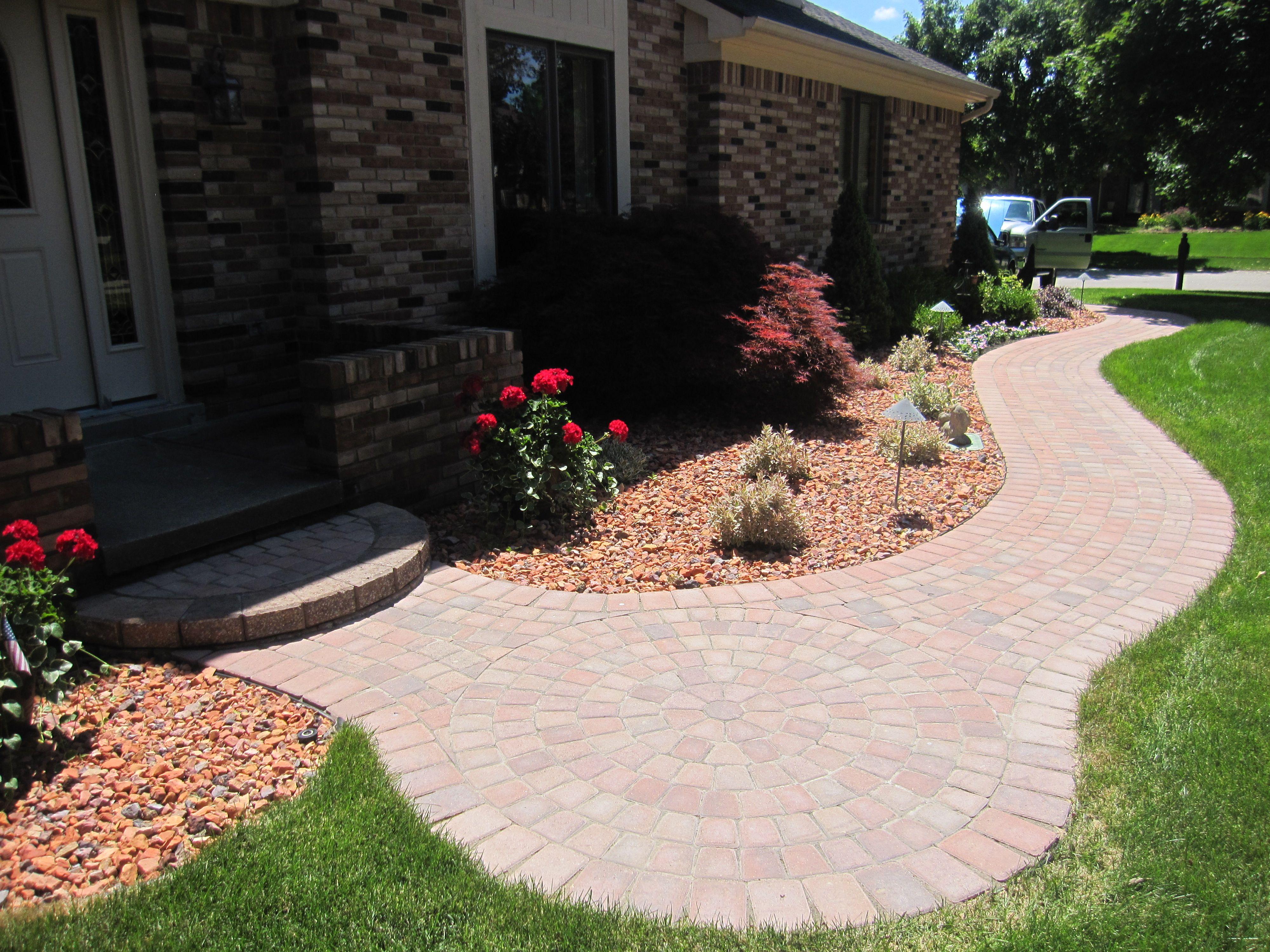 brick paver walkway with circle