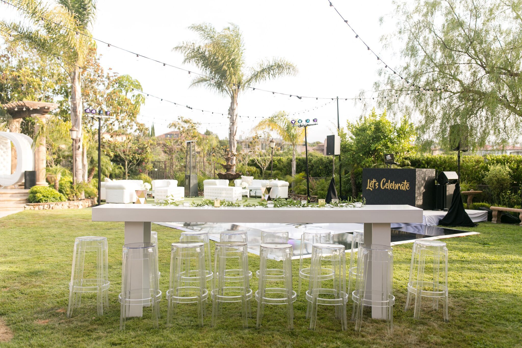 White and clear furniture outdoor seating birthday party and celebration coordinated by gabi events furniture hire elegance