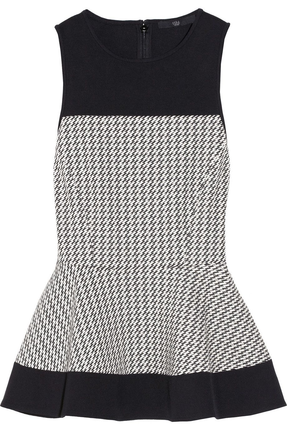 Women can wear houndstooth, too! This peplum #Tibi top is a perfect example.