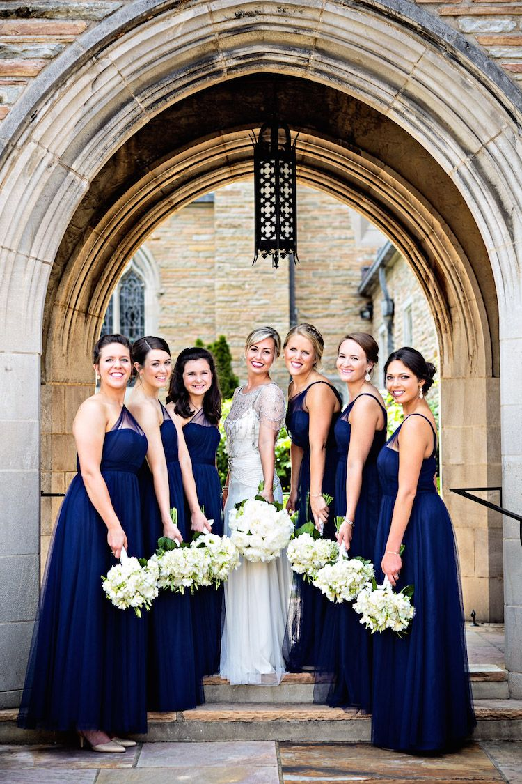 Regal navy wedding navy bridesmaid gowns navy bridesmaids and classic white bouquets to go with navy bridesmaid gowns see more from this regal blue ombrellifo Choice Image