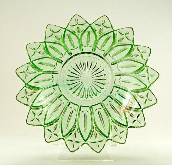 Green Depression glass-not really antique but getting close.  I have this pattern in clear glass along with the matching bowls.  Beautiful for dessert or appetizers!