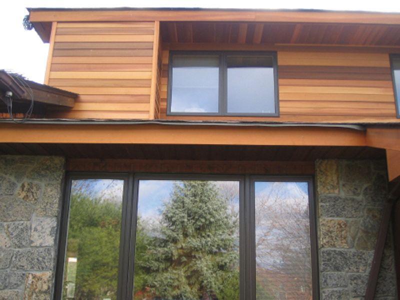 modern cedar horizontal wood siding home with dark shingles and ...