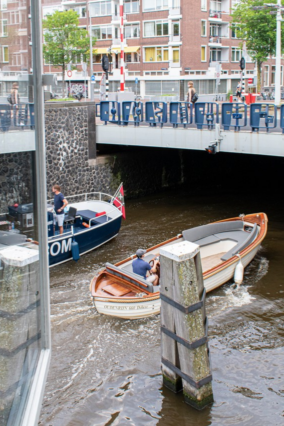 Hotel room view: watching all the boats passing bridge house 204 - Hortusbrug.  #sweetshotel #hortusbrug #getaway #staycation #romantic #view #beautifulview #viewfrommyroom #hotelview #viewfrommywindow #roomwithaview #hotelwithaview #canalviews #riverview #amsterdamview #hortus #hortusamsterdam #amsterdamcenter #amsterdamcentral #centralamsterdam #amsterdam #amsterdamworld #passionpassport #boats #boatwatching #waterview #cityview #photography #hotel #hotelroom #hotels
