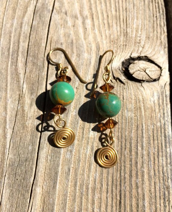 Handmade Turquoise and Golden Brown Chrystal Beads with Gold Wire Swirl Dangle Earrings by #EnamelArtByLeslie on Etsy. #HandmadeEarrings #Turquoise #gold #GoldEarrings #TurquoiseEarrings #TuquoiseandGold