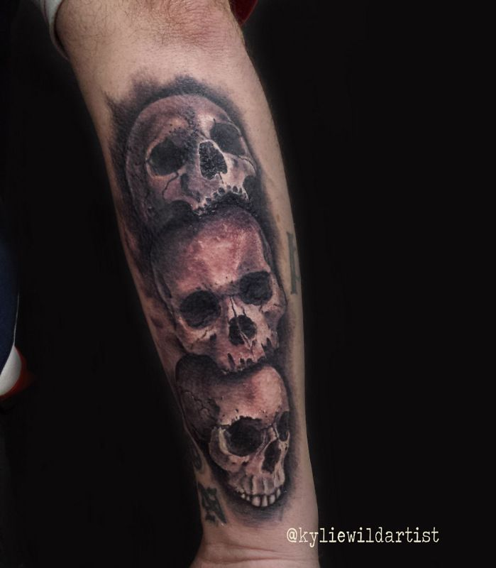 Skull Stack Of Three Back Of Forearm Tattoo Black And Grey Realistic By Kylie Wild Heslop Artist Www Artgonewild Back Of Forearm Tattoo Tattoos Black Tattoos