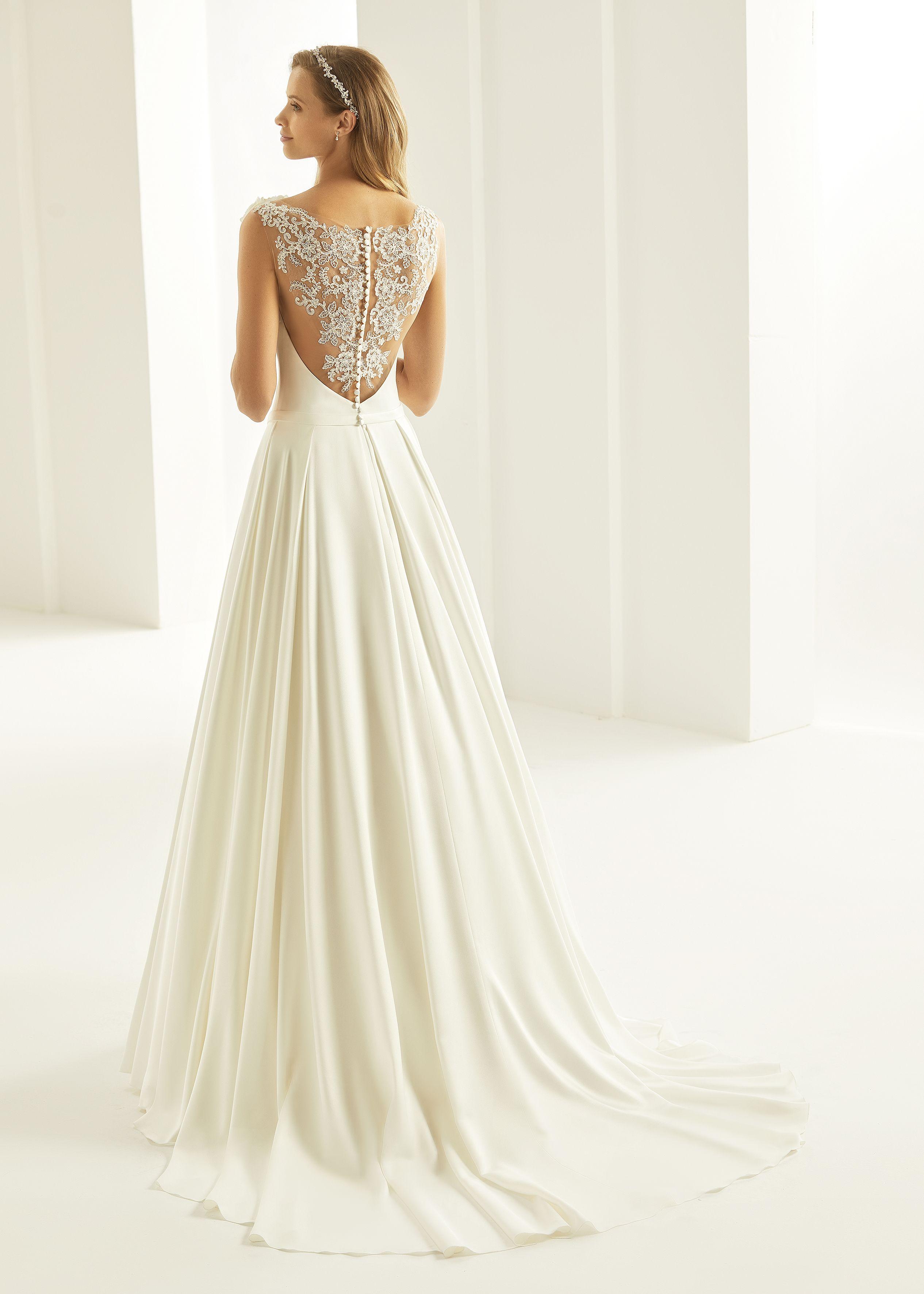 Brautkleid mit Spitzen tattoo im Rücken  Wedding dresses, A-line