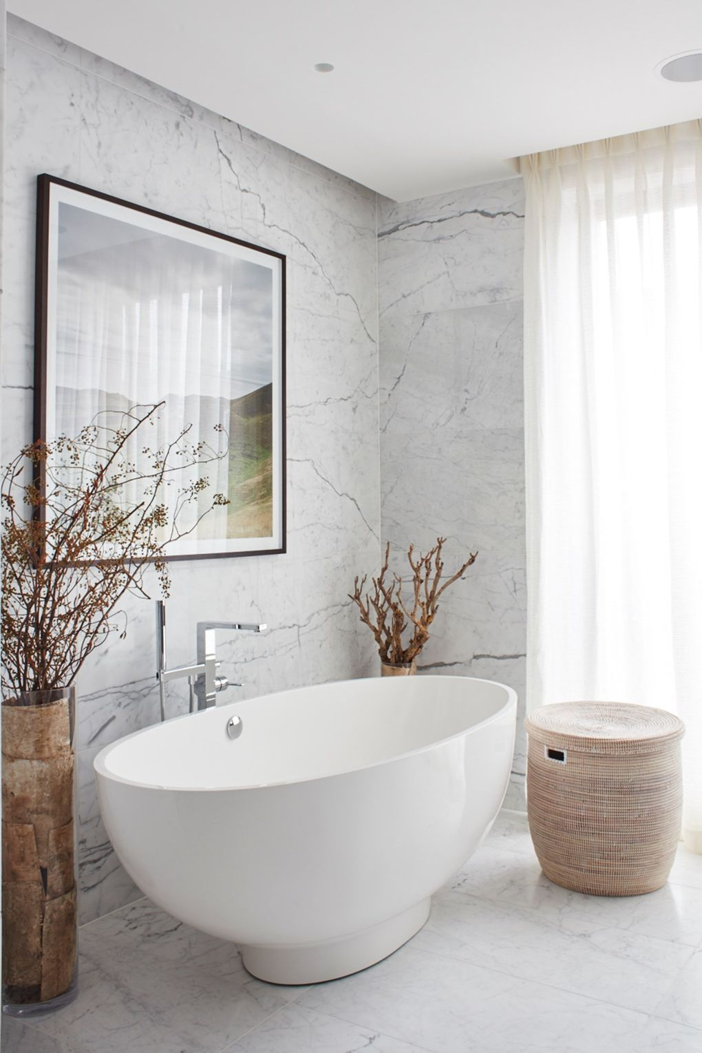 i]The Arabescato-marble-clad main bathroom has a large [link url ...