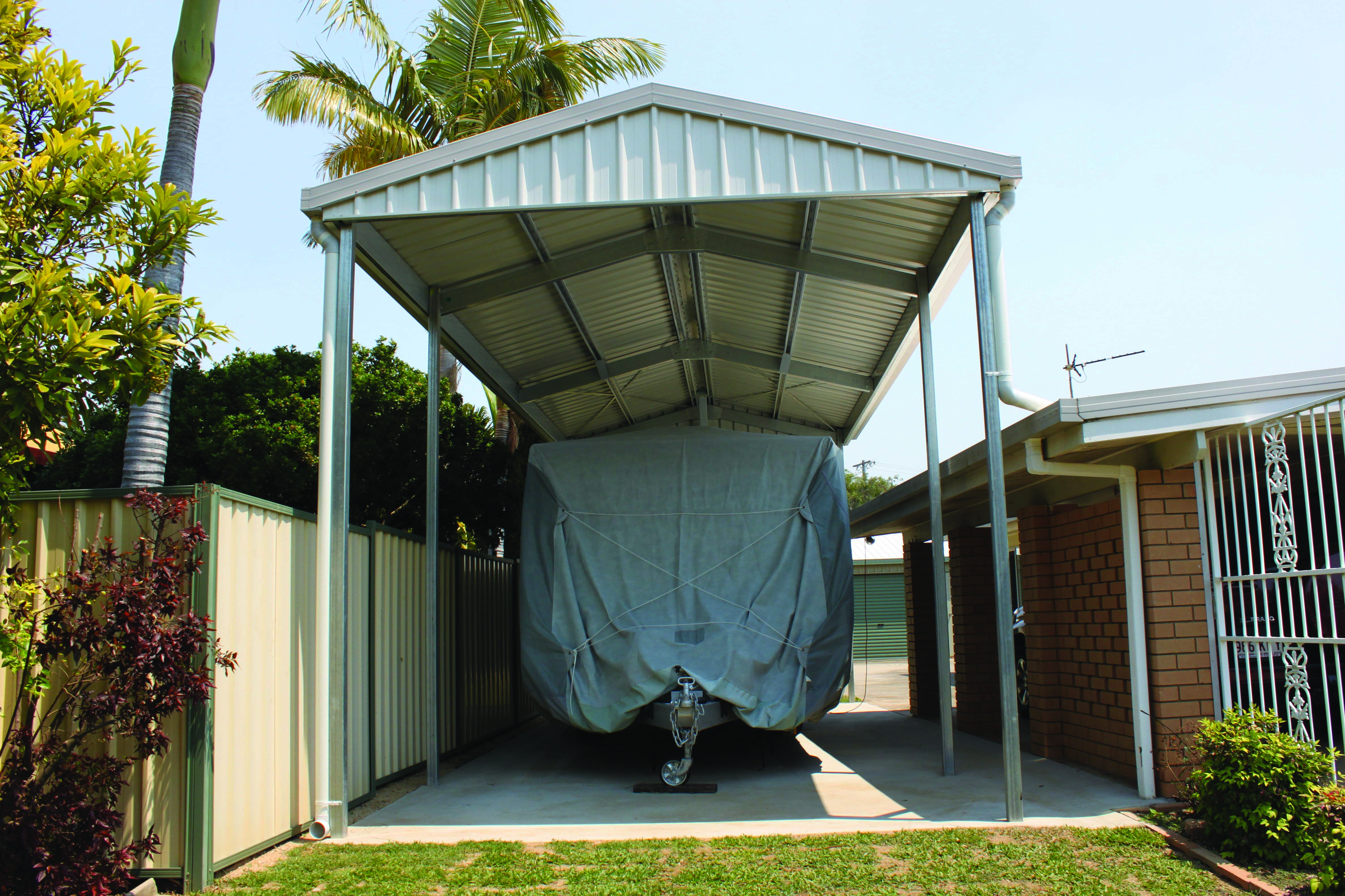 Closing in a carport to make guest suite - Protecting This Boat From The Rain Hail And Shine With A Carport Cladded With Colorbond