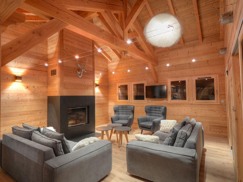 location vacances chalet ar ches la frasse salon avec chemin e sur mesure en granit et. Black Bedroom Furniture Sets. Home Design Ideas
