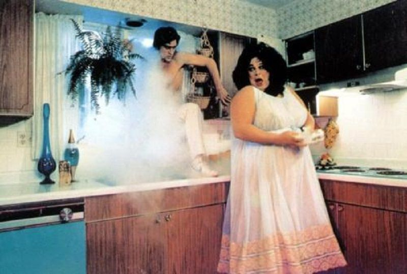 Polyester (1981)  Dir: John Waters Stars: Divine, Tab Hunter, Edith Massey, David Samson  A suburban housewife's world falls apart when her pornographer husband admits he's serially unfaithful to her, her daughter gets pregnant, and her son is suspected of being the foot-fetishist who's been breaking local women's feet.  Watch it here: http://www.watchfree.to/watch-6b27-Polyester-movie-online-free-putlocker.html