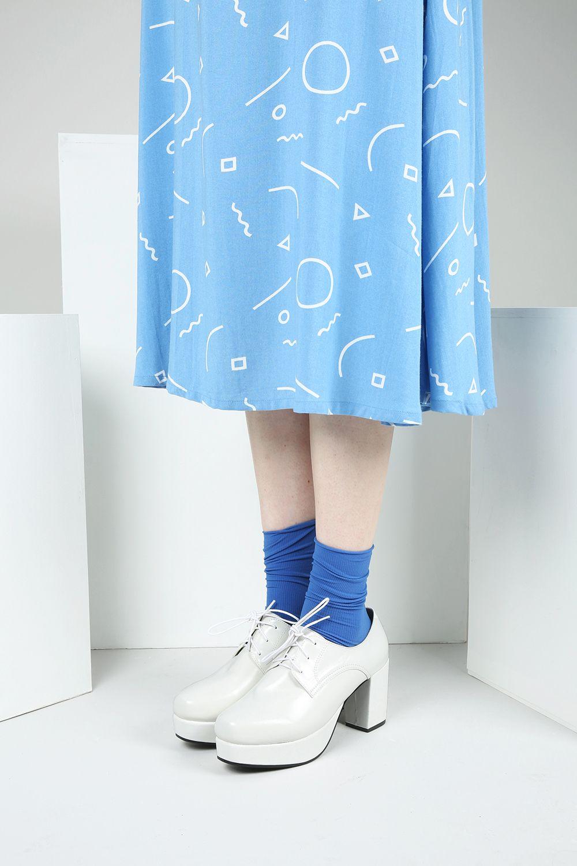 Trapeze Midi Dress http://www.thewhitepepper.com/collections/dresses/products/trapeze-midi-dress Roll Top Pop Socks Blue http://www.thewhitepepper.com/collections/socks/products/roll-top-pop-socks-blue Lace-Up Platform Heel White http://www.thewhitepepper.com/collections/shoes/products/lace-up-platform-heel-white