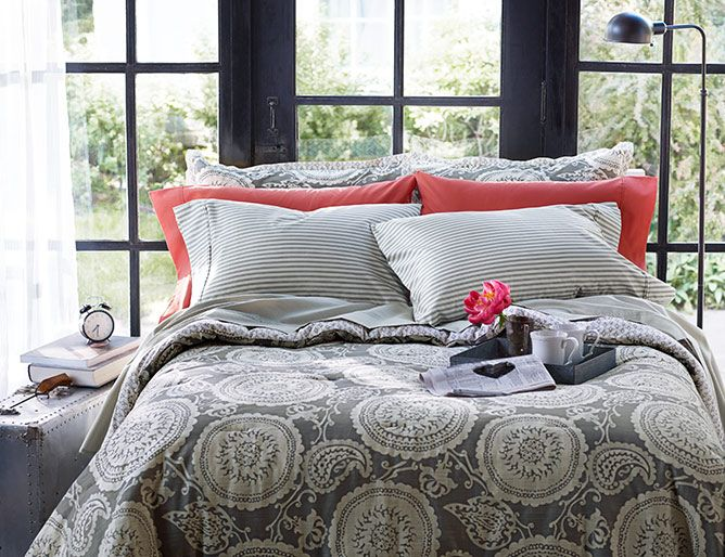 a bed featuring threshold™ suzani comforter in elephant grey with